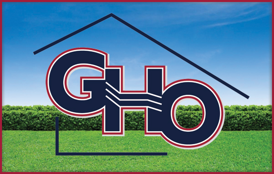 GHO Development Corporation Logo in front of a yard facade